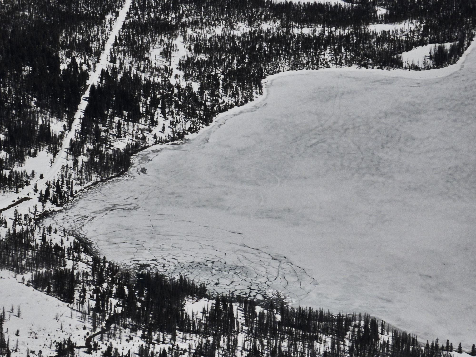 Concentric cracks on the ice-covered surface of Stanley Lake on April 9, 2020